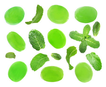Set of mint hard candies and green leaves on white background 스톡 콘텐츠