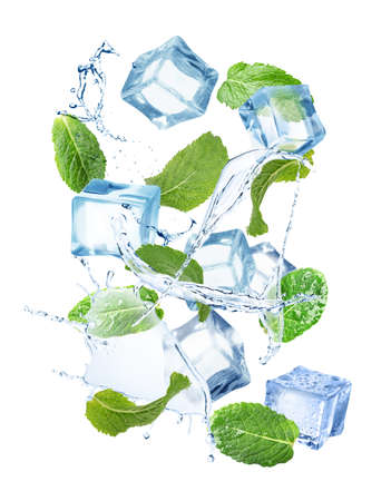 Ice cubes and green mint leaves with water splashes on white background