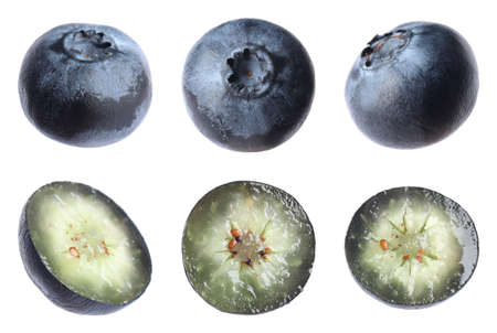 Set of cut and whole blueberries on white background