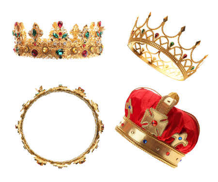 Set of crowns with gemstones on white background