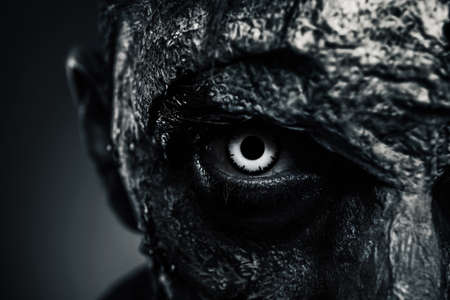 Closeup view of scary zombie on dark background, black and white effect. Halloween monster