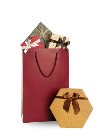 Paper shopping bag and gift boxes isolated on white