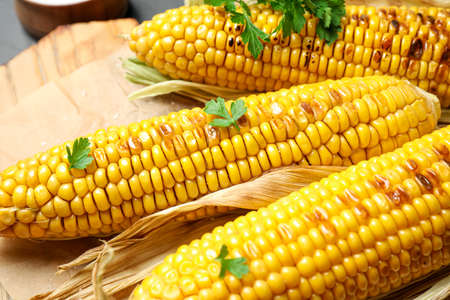 Tasty grilled corn on table, closeup view Stock fotó