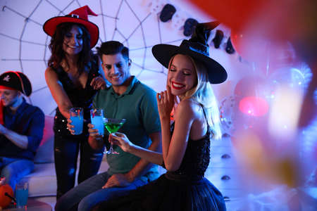 Group of friends having Halloween party at home Standard-Bild