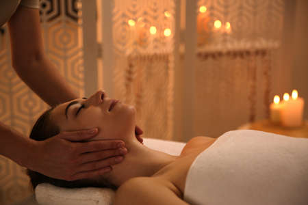 Young woman receiving body massage in spa salon