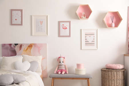 Stylish child's room interior with beautiful pictures and comfortable bed Archivio Fotografico