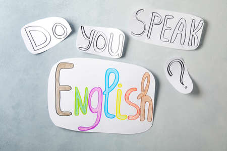 Question DO YOU SPEAK ENGLISH? on light gray background, flat lay
