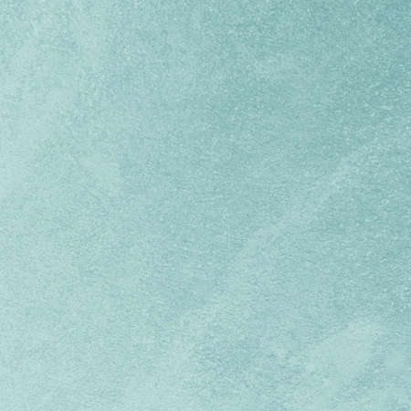 Wall paper design. Texture of light blue concrete surface as background