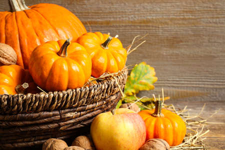 Composition with ripe pumpkins on wooden table, closeup. Happy thanksgiving day 免版税图像