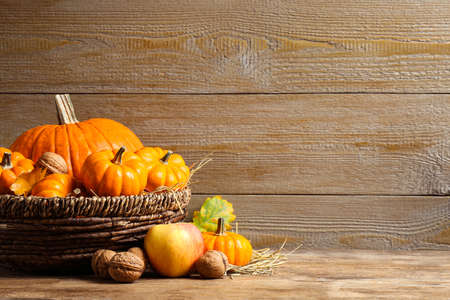 Composition with ripe pumpkins on wooden table, space for text. Happy thanksgiving day