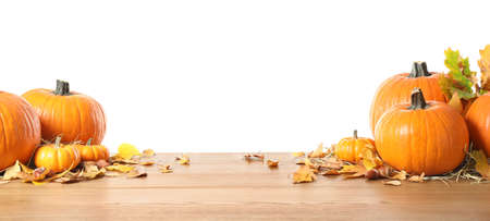 Composition with ripe pumpkins and autumn leaves on wooden table against white background. Happy thanksgiving day