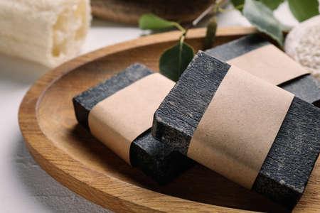 Natural tar soap in wooden board, closeup