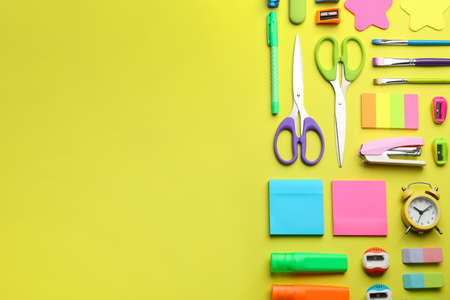 School stationery on yellow background, flat lay with space for text. Back to school