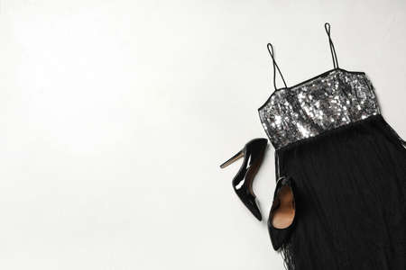 Stylish black dress and shoes on light background, flat lay. Space for text 写真素材