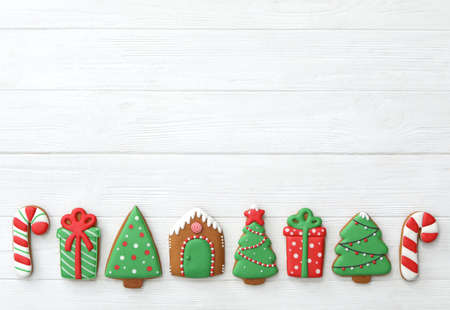 Many different delicious Christmas cookies on white wooden table, flat lay. Space for text Foto de archivo