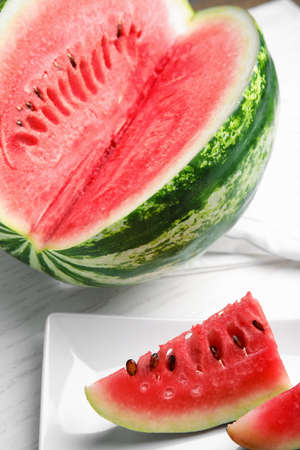Yummy cut watermelon slices on white table
