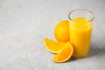 Freshly made orange juice on light table. Space for text