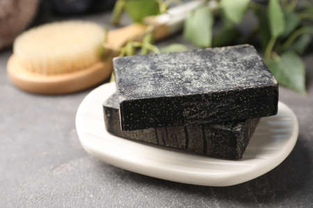 Natural tar soap on gray stone table, closeup