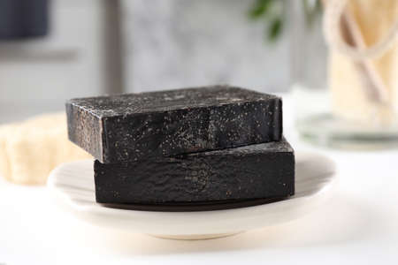 Natural tar soap on white table, closeup 写真素材