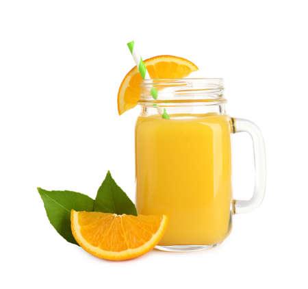 Tasty orange juice in mason jar, fresh fruit and green leaves isolated on white 免版税图像