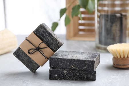 Natural tar soap on light gray table