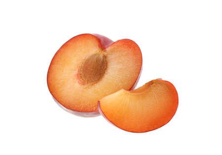 Cut fresh ripe plum isolated on white 免版税图像
