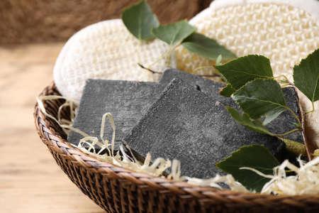 Natural tar soap in wicker basket closeup