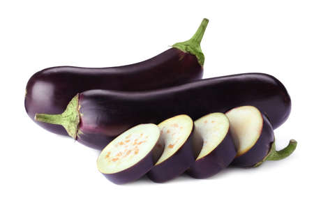 Cut and whole fresh ripe eggplants isolated on white