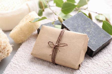 Natural tar soap on soft towel, closeup 写真素材