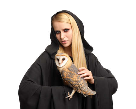 Witch in black mantle with owl isolated on white. Scary fantasy character