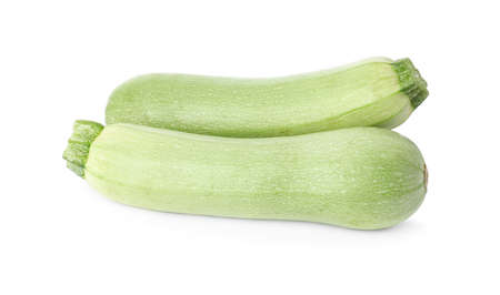 Raw green ripe zucchinis isolated on white
