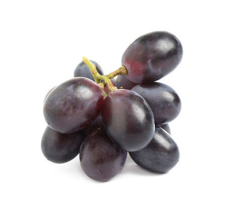 Delicious ripe purple grapes isolated on white