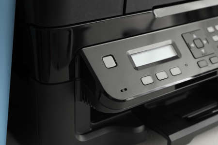 Closeup view of new modern printer with control panel