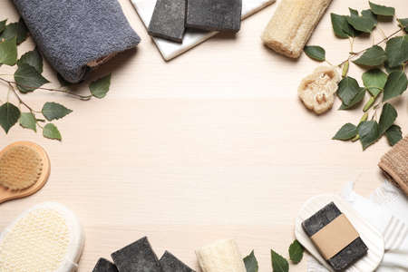 Flat lay composition with natural tar soap on wooden table. Space for text