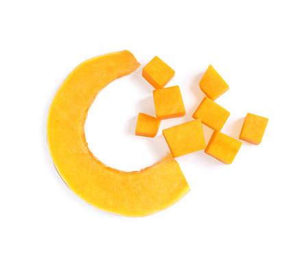 Pieces of ripe orange pumpkin on white background, top view