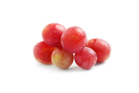 Delicious ripe red grapes isolated on white