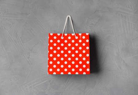 Paper shopping bag hanging on gray wall 版權商用圖片
