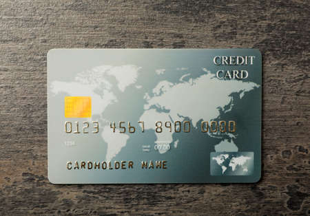 Credit card on gray table, top view