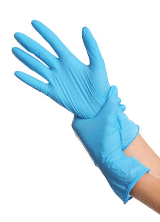Doctor wearing medical gloves on white background, closeup