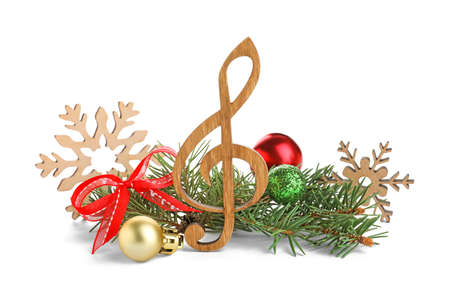 Wooden music note with fir tree branches and Christmas decor on white background Stock Photo