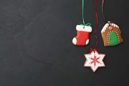Different delicious Christmas cookies on black table, flat lay. Space for text