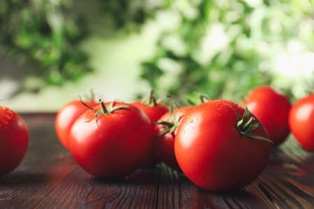 Fresh ripe red tomatoes on wooden table