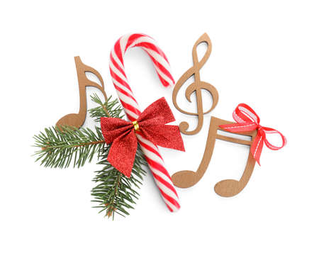 Composition with wooden music notes on white background, top view. Christmas celebration