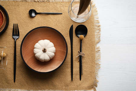 Autumn table setting with pumpkin on white wooden background, flat lay