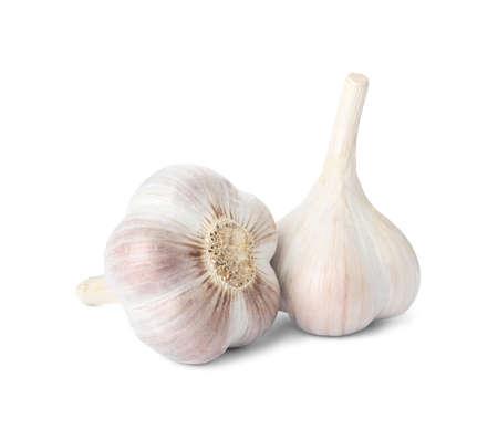 Fresh organic garlic bulbs on white background