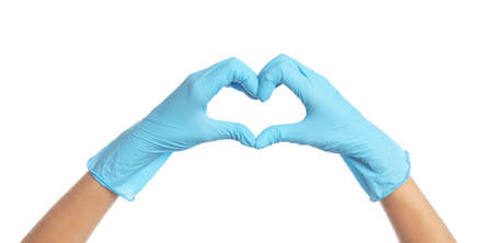 Doctor in medical gloves showing heart with hands on white background, closeup Stock fotó