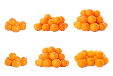 Set of fresh ripe tangerines on white background