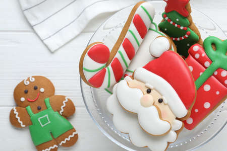 Decorated Christmas cookies on white wooden table, flat lay Stock Photo