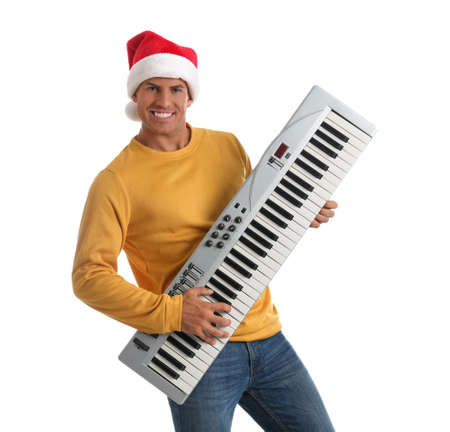 Man in Santa hat playing synthesizer on white background. Christmas music