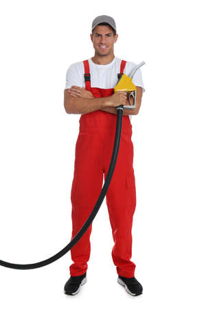 Gas station worker with fuel nozzle on white background Reklamní fotografie